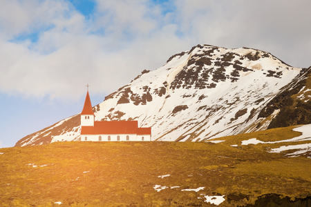spire: Church on high hill mountain, Iceland natural winter season landscape background