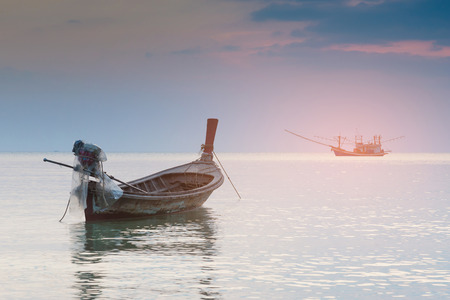 Small fishing boat abandon in ocean skyline, natural landscape background