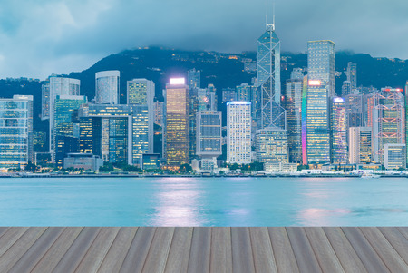 Opening wooden floor, Hong Kong night light central business downtown sea front, cityscape background Stock Photo