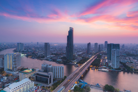 Aerial view Bangkok city river curved with after sunset sky background, Thailand