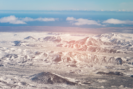 Snow coverd over mountain aerial view in Iceland during winter season