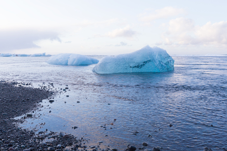 Natural Ice breaking on black small rock sand beach, Iceland winter season landscape background Stock Photo