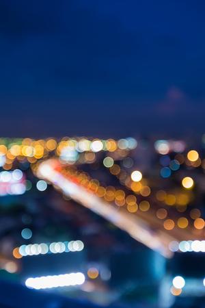 夜ぼやけた光高速道路曲線市ダウンタウンの抽象的な背景 写真素材