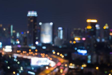 milánó: Night blurred bokeh light city office building, abstract background Stock fotó