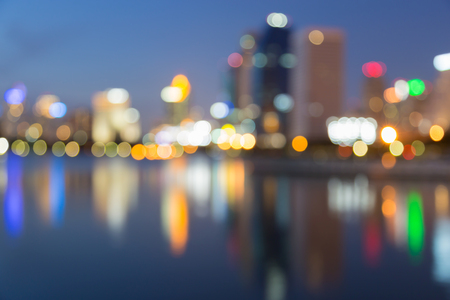 keywords: Twilight blurred bokeh and reflection city office building, abstract background
