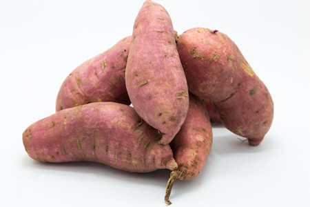 Purple fressh sweet potato on white background Imagens