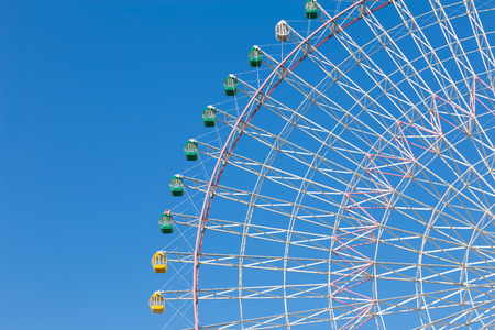 scratched: Path of funfair giant ferris wheel with clear blue sky background