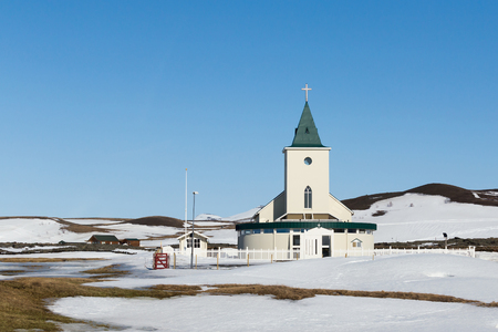 Small cristian temple in winter season with blue clear sky background, Iceland