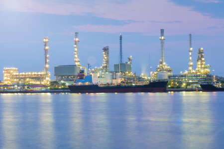 Twilight night view, Oil refinery river front, industrial background Reklamní fotografie