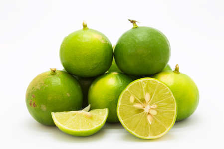 Side fresh limes stack on white background