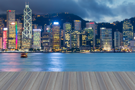 Opening wooden floor, City of HongKong blurred bokeh light seafront, abstract background