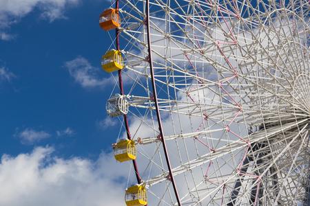 Ferris giant wheel against blue sky in funfair park Stok Fotoğraf