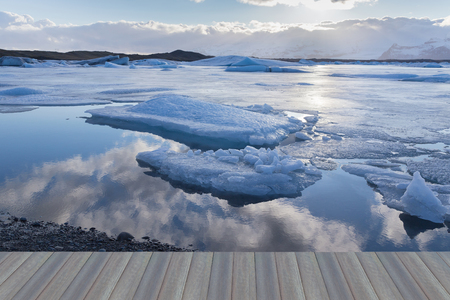 Opening wooden floor, Ice on blue lake with sky reflection, Iceland winter season natural landscape Stock Photo