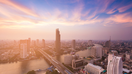 Sunset tone over Bangkok city with river curved , cityscape backgorund Stock Photo
