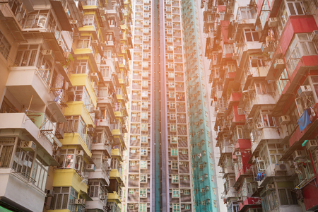 Residence crowded apartment in downtown, Hong Kong cityscape background