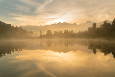 Matheson lake with reflection during sunrise, New Zealand natural landscape background