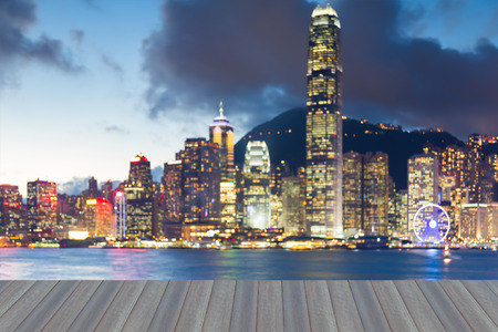 Opening wooden floor, Blurred light night view Hong Kong city downtown, abstract background Stock Photo