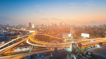 Night city downtown and highway with sunset tone, cityscape background Stok Fotoğraf