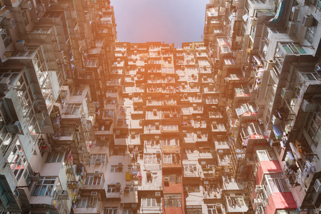 Hong Kong crowded residence apartment bottom view, cityscape downtown background Stock Photo