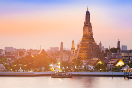 Arun temple river front with after sunset sky background, Thailand historic Landmark Stock Photo