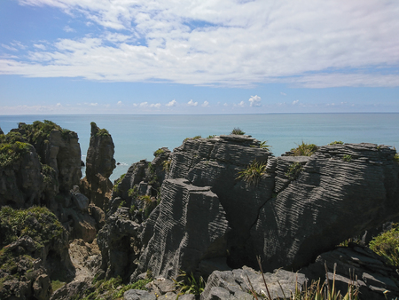 Pancake rock over Panakaiki seacoast skyline, New Zealand natural landscape background