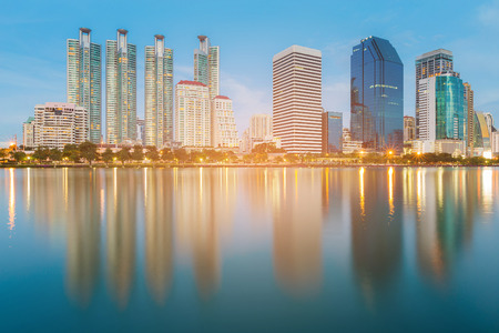 Blue twilight office building with water reflection, cityscape downtown background 版權商用圖片
