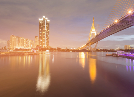 Twilight suspension bridge river front with reflection, night view Stock Photo