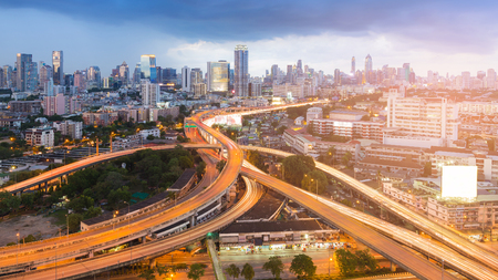 Highway interchange junction with city downtown background, Bangkok Thailand Stock fotó