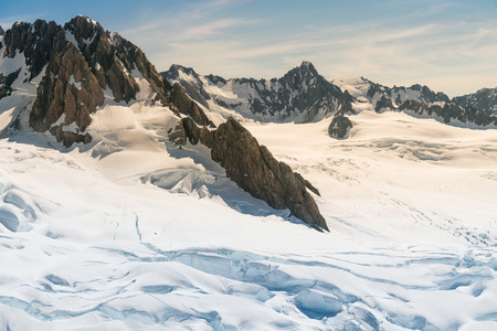 Fox glacier with Tasman mountain, with snow covered, New Zeland natural landscape background