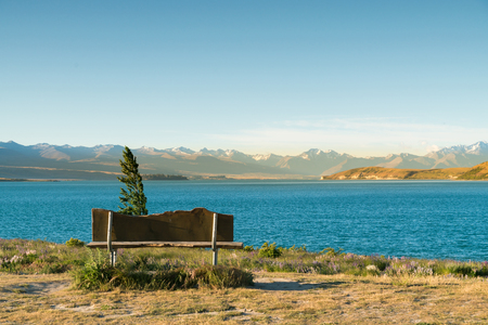 Chair sitting over Tekapo lake view with Mt.Cook background, New Zealand landscape