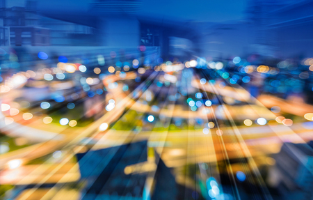 Tunnel train track motion over blurred bokeh city interchanged highway overpass, abstract background Stock Photo