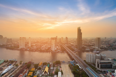 City of Bangkok skyline aerial view with river and sunset sky background, Thailand