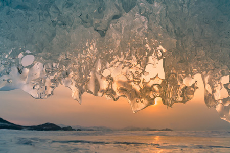 Beautiful Ice caved with sunset sky winter season natural landscape background, Siberia Russia