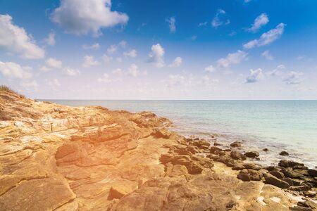 Rocky beach over seacoast skyline, natural landscape background