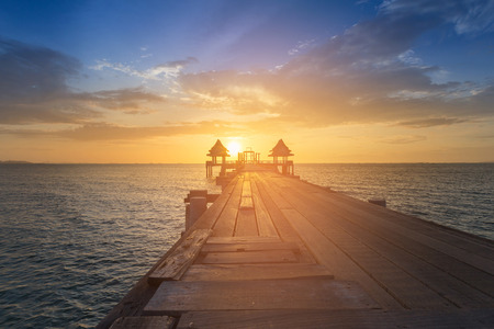 Sunset over wooden walk way with seacoast skyline, natural landscape background