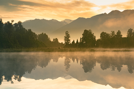 Beautiful mirror water Matheson lake in morning, New Zealand natural landscape background Standard-Bild