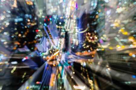 Aerial view blurred light city downtown over train track double exposure, abstract background