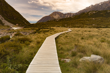 Hooker Valley track, wooden path into Fox mountain, New Zealand natural landscape Stock Photo - 99774197
