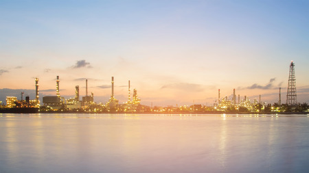 Panorama oil refinery river front during sunrise, industrial background