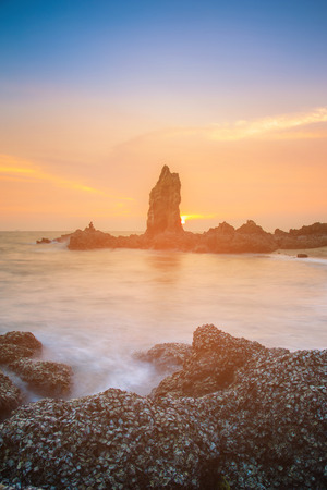 Sheel rock over seacoast with sunset sky background, natural landscape Reklamní fotografie