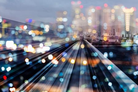 Bokeh city downtown night light with train track over, abstract background 写真素材
