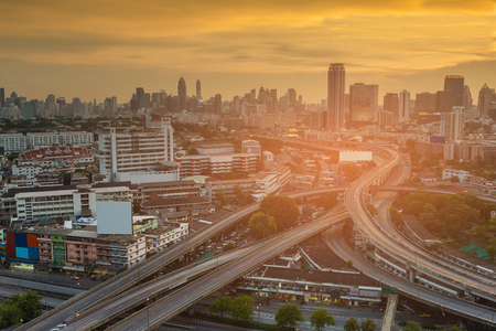 Aerial view city business downtown over highway intersection with sunset tone, cityscape background Reklamní fotografie