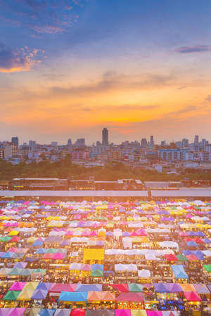 Aerial view multiple colour flea market with after sunset sky background with city building business downtown Stock Photo