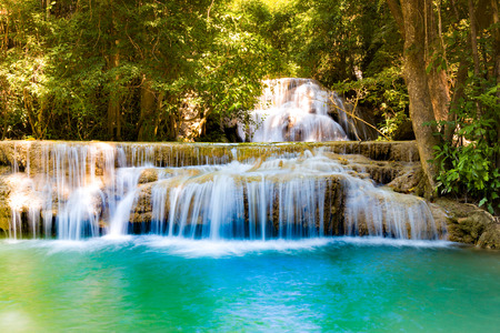 Natural stream waterfall in tropical deep forest landscape background