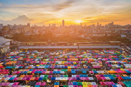 Sunset over Bangkok city business downtown and flea market multiple colour, cityscape background
