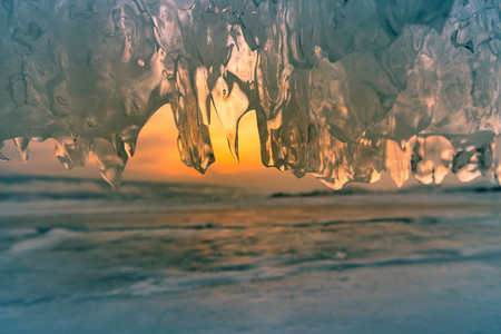 Ice caved with sunset background at Baikal winter water lake natural landscape Stock Photo