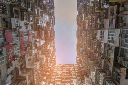 Hong Kong residential apartment bottom view, cityscape background