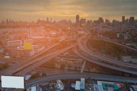 Sunset over Bangkok city central business downtown and Highway intersection, Thailand 免版税图像