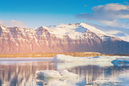 Iceland reflection lake with black volcano mountain, winter season natural landscape background