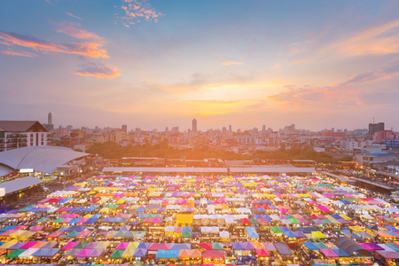 City night market aerial view, multiple colour cityscape background Stock Photo